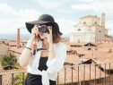 young-woman-wearing-straw-hat-photographing-old-town