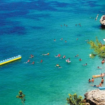 People swimming on a beach in Vlora