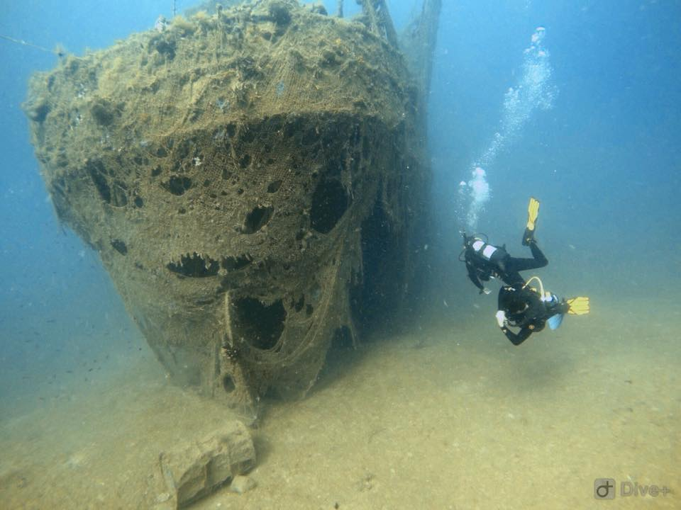 Divers near shipwreck in Albania