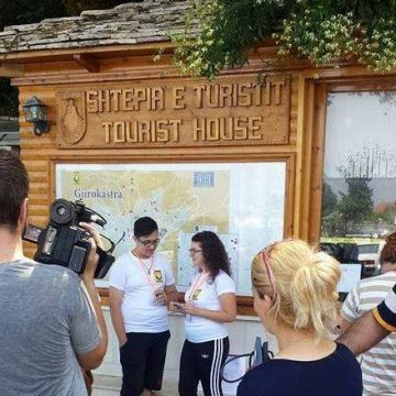 In Gjirokastra, local young adults offer free tour guides for tourists