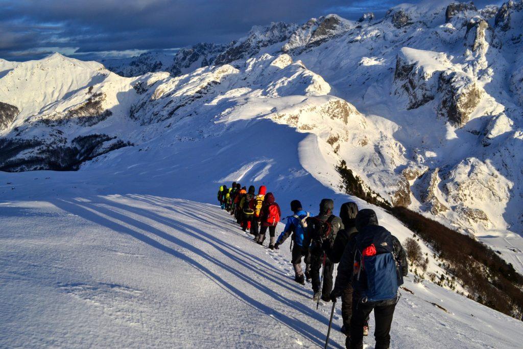 Hikers at Berizhdoli Peak in Lepusha