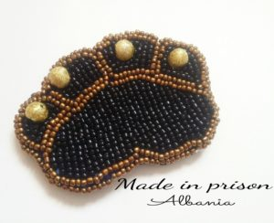 Made in Prison Albania paw bead brooch